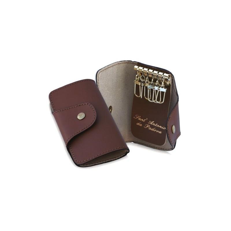0110 portachiavi 6 ganci in pelle chiusura bottoncino for Ganci per appendere chitarre